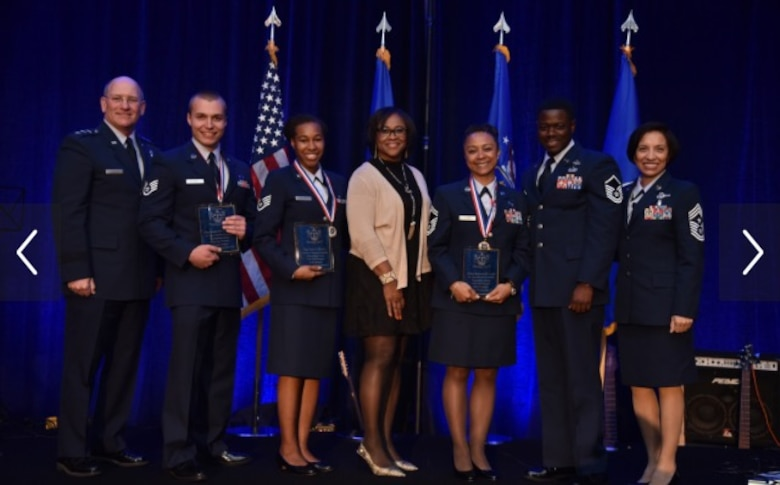 Staff Sgt. Mitchell Ciccarelli, Air Reserve Personnel Center casualty service technician, stands among leadership and other recipients during the Air Force Reserve Command Outstanding Airmen of the Year Banquet April 16, 2016, held in Jacksonville, Fla. Ciccarelli was presented the 2015 Headquarters AFRC Airman of the Year award by Lt. Gen. James F. Jackson, chief of the Air Force Reserve and commander of AFRC. (Air Force courtesy photo)
