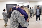 A member of the 814th Military Police Company in Arlington Heights, Ill. embraces their loved one after returning home from Cuba. The 814th MP CO returned from a 10-month deployment at Guantanamo Bay.