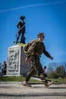 Staff Sgt. Daniel Eddy, staff noncommissioned officer-in-charge for Recruiting Substation Framingham, Massachusetts, passes the Minute Man statue near the end of the 2016 Boston Marathon Tough Ruck at the Minute Man National Historical Park, April 16. The tough ruck has participants hike 26.2 miles with a 30-pound pack in honor of the service men and women who lost their lives in the line of duty.