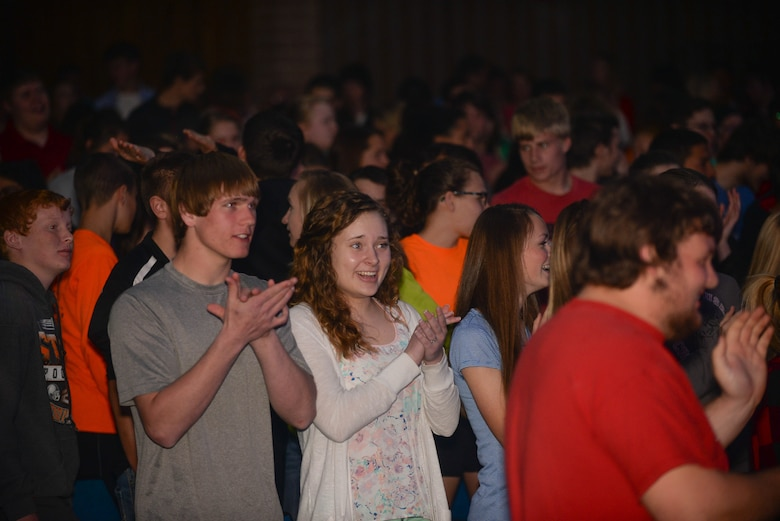 Students from Aurora Public Schools give applause to members of Raptor, an ensemble of the United States Heartland of America band during a concert April 13, 2016 in Aurora Neb. Known throughout the United States for its outstanding performances and recordings, the Heartland of America Band reaches more than one million people annually through live performances, radio and television appearances. (U.S. Air Force photo by Zachary Hada)