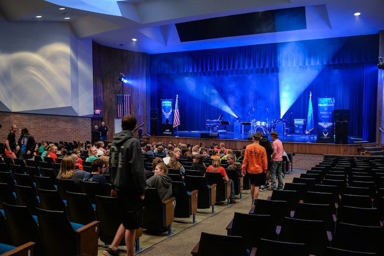 Middle and high school students from Aurora Public Schools assemble in their school auditorium to watch a performance by members of Raptor, an ensemble of the U.S. Air Force Heartland of America Band April 13, 2016, in Aurora, Neb. The Heartland of America Band is a group of Air Force professional musicians whose backgrounds include advanced degrees in music performance and whose broad mastery of musical styles range from classic to contemporary, jazz to country and pop to rock. (U.S. Air Force photo by Zachary Hada)
