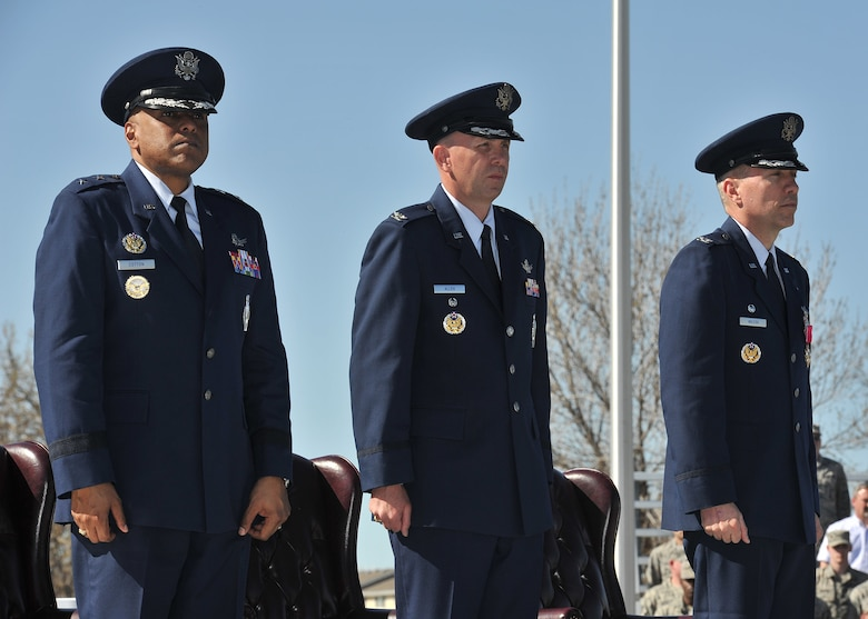 Maj. Gen. Anthony J. Cotton, 20th Air Force commander, Col. Ronald G. Allen, Jr., 341st Missile Wing commander, and Col. John T. Wilcox II, previous 341 MW commander, rise for the Air Force song at the completion of the 341 MW change of command ceremony April 19, 2016, at Malmstrom Air Force Base, Mont. (U.S. Air Force photo/John Turner)