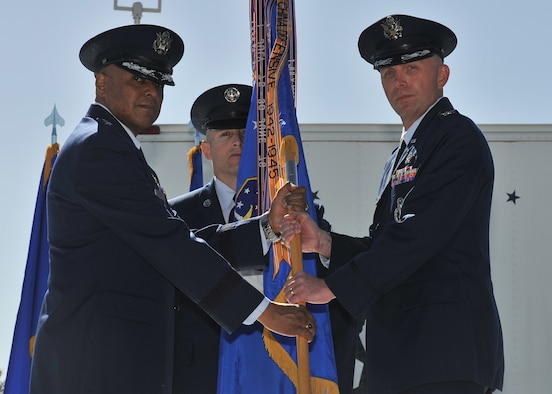 Maj. Gen. Anthony J. Cotton, 20th Air Force commander, left, presents the 341st Missile Wing guidon to Col. Ronald G. Allen, Jr., right, as Allen takes command of the wing during a ceremony on Malmstrom Air Force Base, Mont., April 19, 2016. Chief Master Sgt. Thomas Stiles, 341 MW command chief master sergeant, looks on. As one of Air Force Global Strike Command's three Minuteman III intercontinental ballistic missile wings, the 341 MW provides strategic deterrence for the nation through the operation of 150 land-based ICBMs. (U.S. Air Force photo/John Turner)