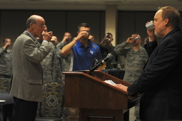 Jeff Thatcher, Children of the Doolittle Raiders president and son of Staff Sgt. David Thatcher, raises his glass to toast the Doolittle Raiders April 18, 2016, at Little Rock Air Force Base, Ark. The Doolittle Raiders consisted of 80 Army Air Corps members who volunteered to make the first United States assault on the Japanese after the attack on Pearl Harbor. (U.S. Air Force photo by Airman 1st Class Mercedes Taylor)