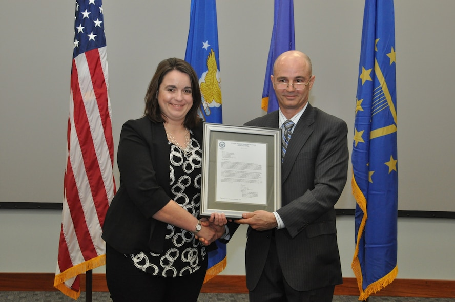 Leonard Litton III, Department of Defense Director of Personnel Risk Reduction presented a congratulatory letter from Brad Carson, performing the duties of the Principal Deputy Under Secretary of Defense for Personnel and Readiness to Ruth Moser, director of the Sensors Directorate during the directorate's OSHA Voluntary Protection Program Star Site award recognition ceremony April 13. The letter stated that the directorate is one of only 56 certified VPP Star sites in the Department of Defense and one of less than 2,300 OSHA certified VPP Star sites in the country. (U.S. Air Force photo/Bryan Ripple)