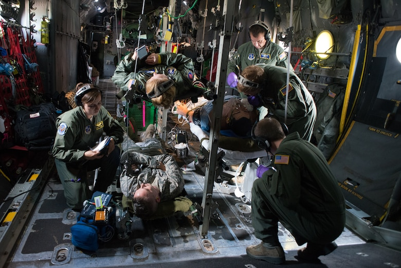 Airmen from a variety of Aeromedical Evacuation Squadrons attend to simulated medical challenges as part of the Multiple Aircraft Training Opportunity Program training event held at Will Rogers Air National Guard Base, Oklahoma City, April 15-16, 2016. The 137th Aeromedical Evacuation Squadron hosted five other aeromedical squadrons at the two day event. (U.S. Air National Guard photo by Master Sgt. Andrew LaMoreaux/Released)