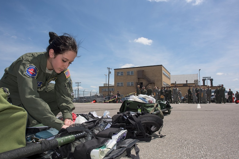 U.S. Air Force Senior Airman First Class Dominique Dimatteo, assigned to the 142nd Aeromedical Evacuation Squadron, digs through an equipment bag during a training event on Will Rogers Air National Guard Base, Okla., April 15, 2016. (U.S. Air National Guard photo by Tech. Sgt. Caroline Essex/Released)