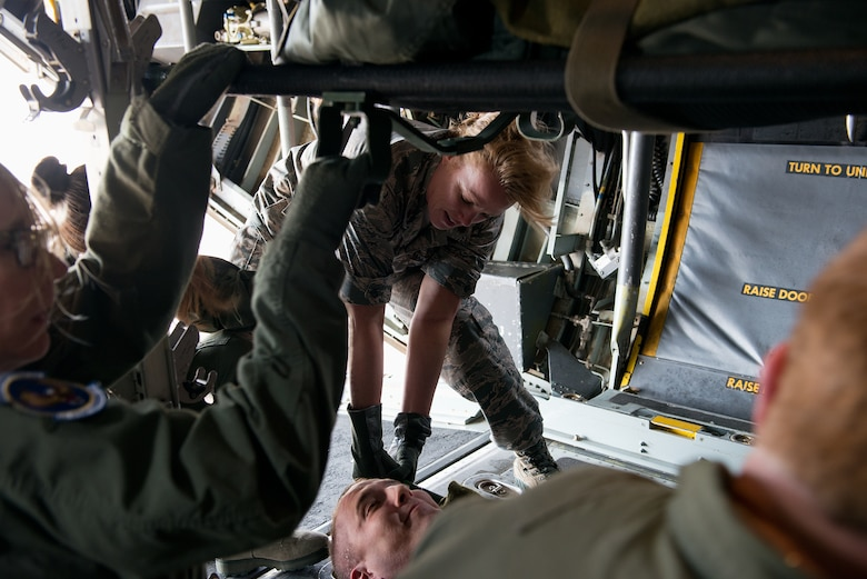 Maj. Ellen Osbourne from the 156th Aeromedical Evacuation Squadron, Charlotte, North Carolina, helps secure simulated patients as part of the Multiple Aircraft Training Opportunity Program training event held at Will Rogers Air National Guard Base, Oklahoma City, April 15-16, 2016. The 137th Aeromedical Evacuation Squadron hosted five other aeromedical squadrons at the two-day event. (U.S. Air National Guard photo by Master Sgt. Andrew LaMoreaux/Released)
