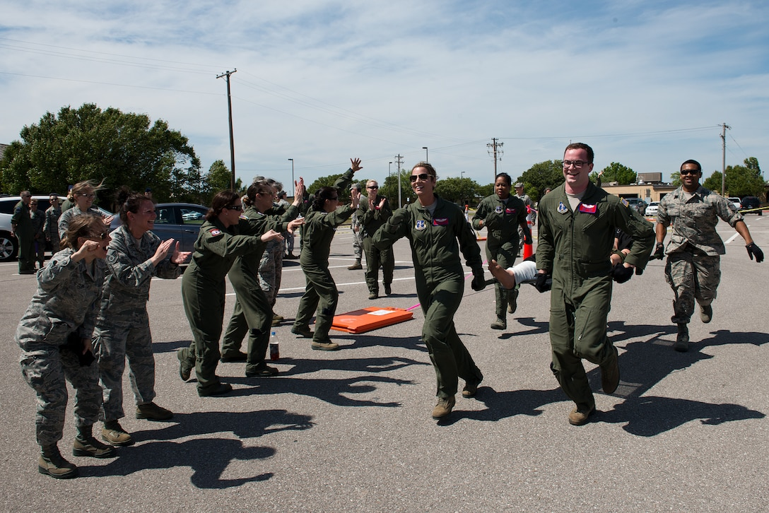 Airmen from the 137th Aeromedical Evacuation Squadron race to the finish line during a custom litter carry obstacle course as part of the Multiple Aircraft Training Opportunity Program training event held at Will Rogers Air National Guard Base, Oklahoma City, April 15-16, 2016. The 137th Aeromedical Evacuation Squadron hosted five other aeromedical squadrons at the two day event. (U.S. Air National Guard photo by Master Sgt. Andrew LaMoreaux/Released)