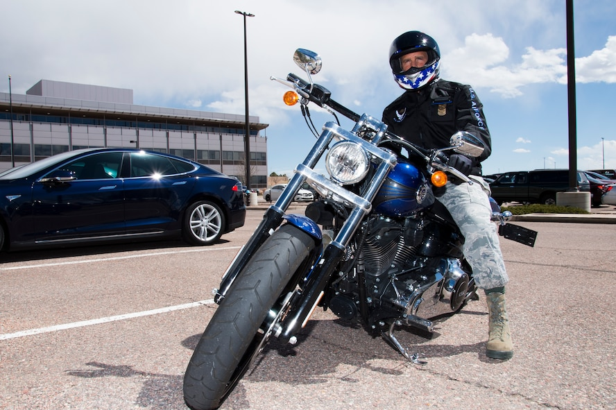 Chief Master Sgt. John Bentivegna, 50th Space Wing command chief, encourages Airmen at Schriever Air Force Base, Colorado, to ride safely and take advantage of the free motorcycle safety courses. The Air Force requires its motorcyclists to receive an initial motorcycle safety course followed by a refresher course once every five years. (U.S. Air Force photo/Tech. Sgt. Julius Delos-Reyes)