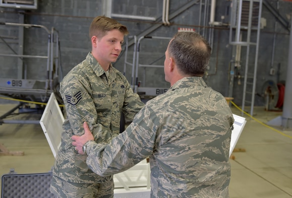 U.S. Air Force Vice Chief of Staff Gen. David L. Goldfein speaks with Staff Sgt. Gregory Beach, 86th Maintenance Squadron member, during his visit to Ramstein Air Base, Germany, 18 April 2016. Beach gave Goldfein a brief on a unique innovation developed and implemented locally where a filing cabinet was converted into fuel tank trainer. The fuel trainer was constructed out of the filing cabinet, expended parts, sheet metal and fasteners; the trainer eliminates exposure to hazardous fuel tanks on operational aircraft and without this innovative tool the unit would need to gain access to a wing section of a C-130J Hercules to ensure personnel remain trained. (U.S. Air Force photo/1st Lt. Clay Lancaster)