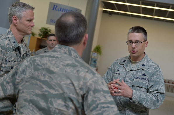 U.S. Air Force Lt. Col. Kyle Korver, 721st Aerial Port Squadron commander, and Col. Charles Henderson, 521st Air Mobility Operations Wing vice commander, brief Vice Chief of Staff Gen. David L. Goldfein during his visit to Ramstein Air Base, Germany, 18 April 2016. Korver, and other members of AMOW and the 86th Airlift Wing, gave Goldfein a walking tour of the passenger terminal where less a month prior the installation played a critical role in ensuring more than 700 dependents were cared for during the ordered departure of DoD civilians and dependents from Turkey. Goldfein and his wife, Dawn, visited the installation to gain insight into Ramstein mission sets and the innovative ways Airmen are making the mission happen in U.S. Air Forces in Europe. (U.S. Air Force photo/1st Lt. Clay Lancaster)