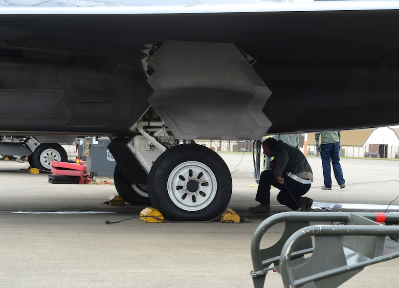 Maintenance Airmen assigned to the 325th Maintenance Squadron, Tyndall Air Force Base, Fla., perform pre-flight checks on an F-22 Raptor at Royal Air Force Lakenheath, England, April 18, 2016. The F-22s deployed from the 95th Fighter Squadron at Tyndall Air Force Base, Fla., and will be conducting air training exercises with other U.S. and Royal Air Force aircraft. (U.S. Air Force photo by Senior Airman Dawn M. Weber/Released)