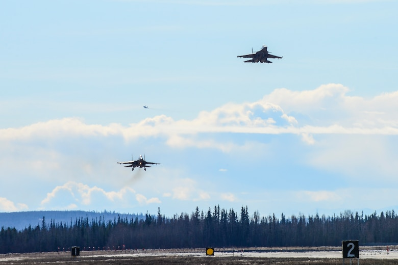 Indian Air Force Su-30MKI fighter aircraft prepare to land at Eielson Air Force Base, Alaska, April 16, 2016. Indian Air Force airmen arrived at Eielson in preparation for RED FLAG-Alaska 16-1. RF-A is a series of Pacific Air Forces commander-directed field training exercises for U.S. and partner nation forces, providing combined offensive counter-air, interdiction, close air support and large force employment training in a simulated combat environment. (U.S. Air Force photo by Staff Sgt. Joshua Turner/Released)