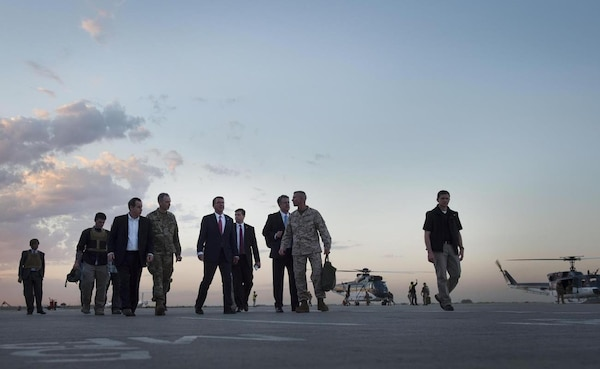 Defense Secretary Ash Carter, center, departs the Baghdad International Airport, April 18, 2016. (DoD photo by U.S. Air Force Senior Master Sgt. Adrian Cadiz)
