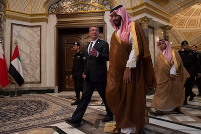 "Defense Secretary Ash Carter speaks with Saudi Arabia's Deputy Crown Prince and Defense Minister Mohammed bin Salman as the secretary arrived for the U.S.-Gulf Cooperation Council Summit in Riyadh, Saudi Arabia, April 20, 2016. Carter visited Saudi Arabia to help accelerate the lasting defeat of the Islamic State of Iraq and the Levant and to participate in the U.S.-GCC Summit. During his April 27, 2016, testimony before the Senate Appropriations defense subcommittee on DoD's fiscal year 2017 defense budget request, Carter said the budget request recognizes the changing character of war and gives the department the means to change in ""fundamental but carefully considered ways"" in a new strategic era.  DoD photo by Air Force Senior Master Sgt. Adrian Cadiz"