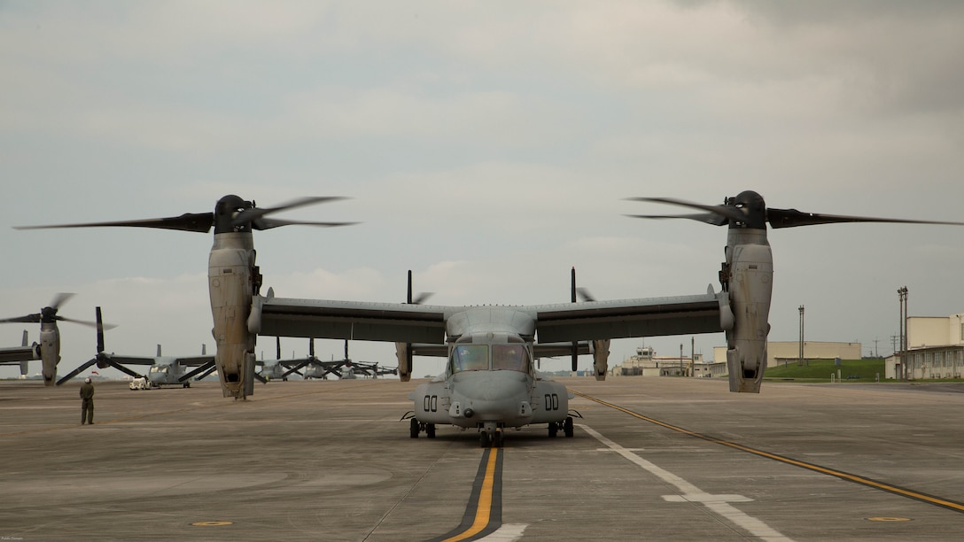 MV-22 Ospreys with Marine Medium Tiltrotor Squadron 265, 31st Marine Expeditionary Unit, await the green light for takeoff April 17, 2016 on Marine Corps Air Station Futenma, Japan. United States Forces, Japan is providing operational airlift support in coordination with the Government of Japan's efforts to provide relief following the devastating earthquake near Kumamoto.