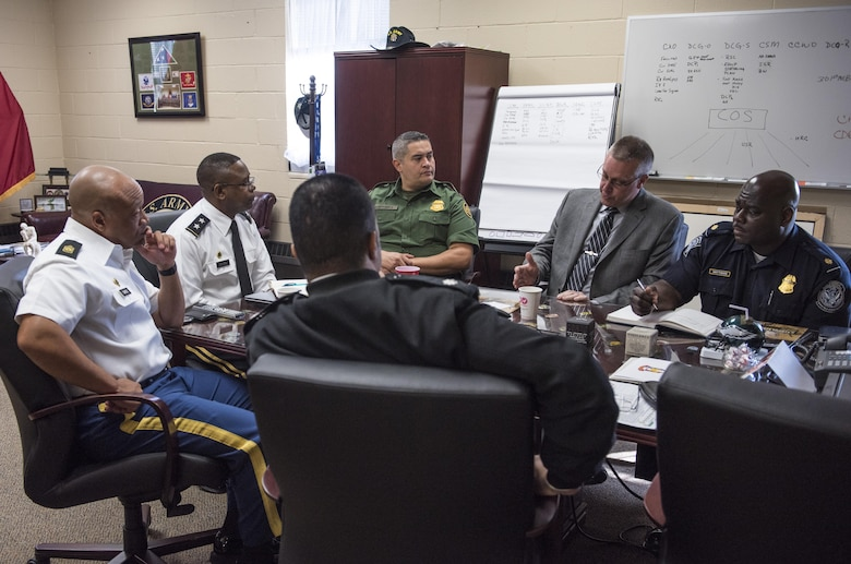 Command Sgt. Maj. Craig Owens (left), senior enlisted advisor, and Maj. Gen. Phillip Churn, commanding general of the 200th Military Police Command, meet with senior leaders of the Customs and Border Protection's National Frontline Recruitment Command, for a discussion about careers available to U.S. Army Reserve Soldiers, April 15, at the MP's headquarters, Fort Meade, Maryland. (U.S. Army photo by Master Sgt. Michel Sauret)