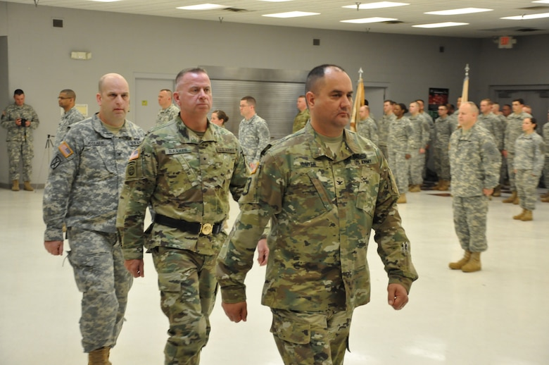Army Reserve Col. Stephen R. Smith, incoming 643rd Regional Support Group commander, followed by Brig. Gen. Vincent B. Barker, commanding general of the 310th Sustainment Command (Expeditionary), and Col. William J. McLaen, outgoing commander of the 643rd RSG march to the side of formation as the change of command ceremony of the 643rd RSG is completed, April 9, at the unit's Whitehall, Ohio, Army Reserve Center headquarters.