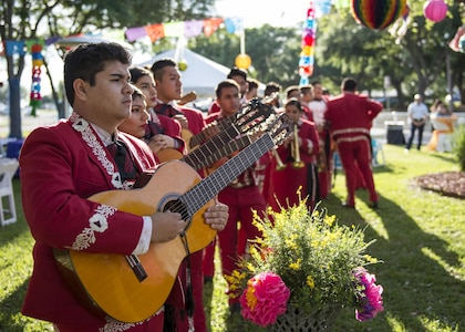 A mariachi band gets ready to perform April 13 during the Air Education and Training Command Fiesta Reception at Joint Base San Antonio-Randolph. Over the past century, Fiesta has grown into a celebration of San Antonio's rich and diverse cultures. During the event military representatives throughout San Antonio participate in receptions, parades, pilgrimages and memorials.
