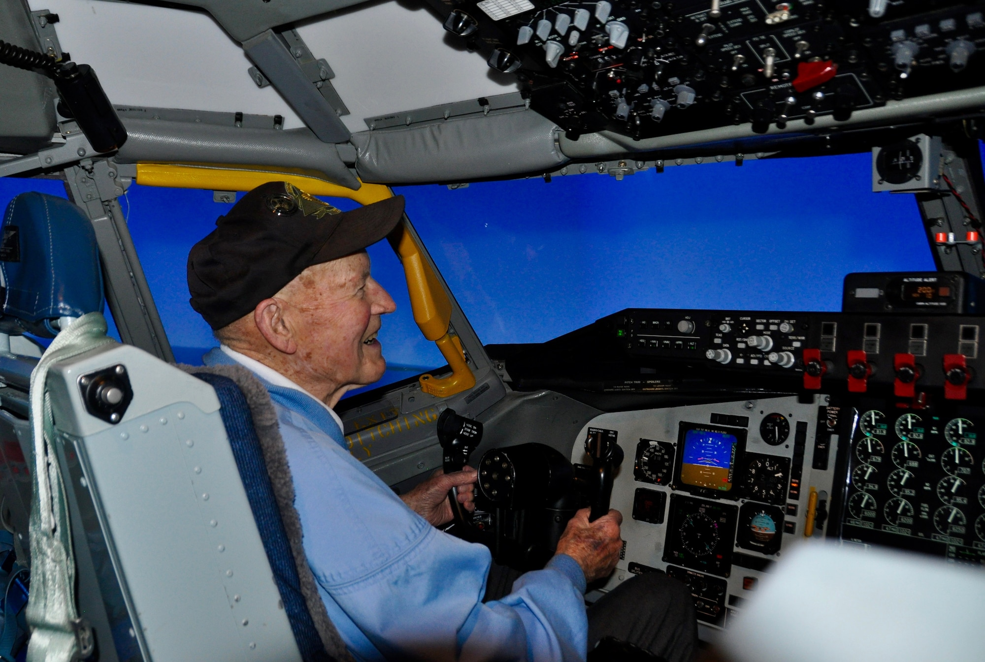 Former Staff Sgt. David Thatcher, one of two surviving Doolittle Raiders, pilots a KC-135 Stratotanker flight simulator April 18, 2016, at Fairchild Air Force Base, Wash. The simulator was configured to recreate the path 16 B-25 Mitchell aircraft flew over Tokyo on April 18, 1942. (U.S. Air Force photo/2nd Lt. Shelley Gregory)