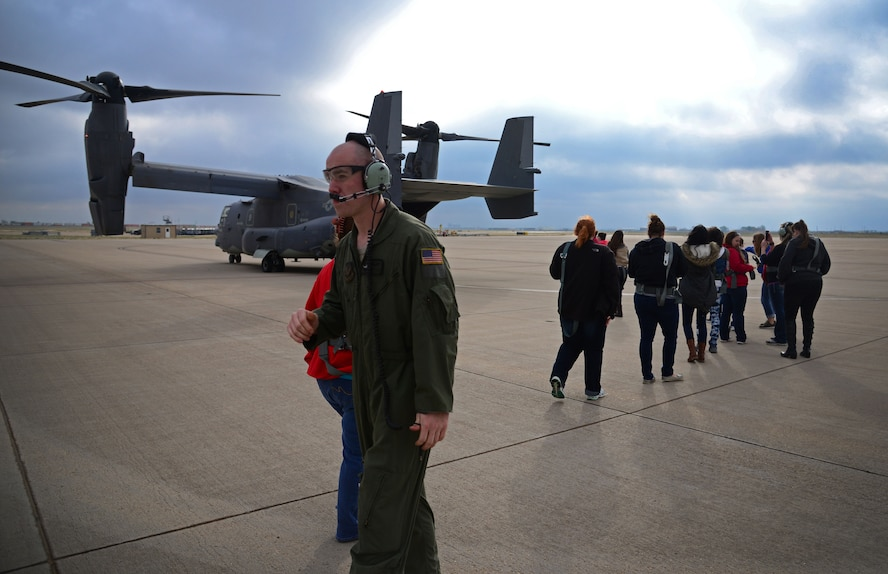 An aircrew member provides a flightline escort to dependents during Spouse Flight Day April 15, 2016, at Cannon Air Force Base, N.M. This was one of the first groups to board the CV-22 Osprey as part of their orientation flight incentive. (U.S. Air Force photo/Staff Sgt. Alexx Pons)