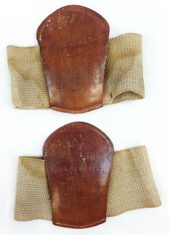 Combat boots during World War I tended to lack the cushion and shock absorption that modern-day combat boots are designed to have.These metatarsal pads were worn with the elastic strap over the top of one's foot.They hold the pad in place over the bottom and just behind the ball of the foot at the arch that runs across the width of the foot.These pads provided comfort and helped prevent pain and numbness caused by overextension of the toes and arch during long marches and constant standing.These WWI pads are leather stuffed with cloth and batting. (U.S. Air Force photo)