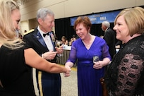 151017-N-HW977-214 RIVERSIDE, Calif. (Oct. 17, 2015) Kim Kruzel, Naval Surface Warfare Center (NSWC), Corona Division comptroller, right, and Laura Hewitt, Performance Assessment Department head, greet Sam Frazier, NSWC Corona legal counsel, and his daughter before inaugural Inland Empire Navy Birthday Ball. The sold-out event, to commemorate the Navy's 240th birthday, included dinner, ceremonies, music, dancing and a keynote address by U.S. Representative Ken Calvert (R-Corona). All proceeds will benefit the Navy-Marine Corps Relief Society. (U.S. Navy photo by Greg Vojtko)  PUBLIC RELEASE REVIEW:  Public Affairs:  PAO Troy Clarke  signature  _________________________ date ________