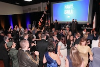 151017-N-HW977-748 RIVERSIDE, Calif. (Oct. 17, 2015) Guests jam the dance floor as TMK Allstarz perform during the inaugural Inland Empire Navy Birthday Ball. The sold-out event, to commemorate the Navy's 240th birthday, included dinner, ceremonies, music, dancing and a keynote address by U.S. Representative Ken Calvert (R-Corona). All proceeds will benefit the Navy-Marine Corps Relief Society. (U.S. Navy photo by Greg Vojtko/Released)
