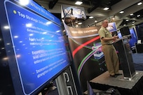 """160217-N-HW977-386 SAN DIEGO, Calif. (Feb. 17, 2015) Capt. Stephen H. Murray, commanding officer of Naval Surface Warfare Center (NSWC), Corona Division, speaks during WEST 2016, a three-day conference co-sponsored by Armed Forces Communications and Electronics Association (AFCEA) and U.S. Naval Institute (USNI). Murray described bringing """"Top Gun"""" to surface warfare, building a single metrology/calibration enterprise and using business intelligence to help the fleet plan maintenance availability. (U.S. Navy photo by Greg Vojtko/Released)"""