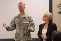 160408-N-HW977-089 MARCH AIR RESERVE BASE, Calif. (April 8, 2016) Brig. Gen. Russell Muncy, commander, 452nd Air Mobility Wing, left, and Dianne Costlow, Naval Surface Warfare Center (NSWC), Corona Division deputy technical director, respond to questions during Leadership Riverside Military and Homeland Security Day event. Costlow briefed the local business leaders on NSWC Corona's mission to enable warfighters to train, fight and win through measurement, analysis and independent assessment, as well as its economic and social contributions to the region. (U.S. Navy photo by Greg Vojtko/Released)
