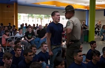 A poolee from Recruiting Sub-Station Fort Worth gets told to scream louder by a drill instructor during the annual pool function family night at Brewer High School in Fort Worth, Texas, April 19, 2016. More than 100 poolees and family members from the metropolitan area attended the family night to prepare them for Marine Corps recruit training.
