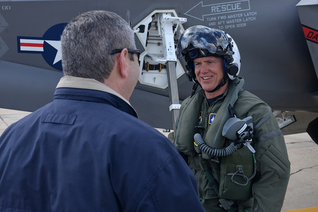 Navy Capt. Mark Weisgerber, the 33rd Fighter Wing vice commander, is greeted by Greg Hoffman, the 570th Aircraft Maintenance Squadron director, at Hill Air Force Base, Utah, April 15, 2016. Weisgerber flew an F-35C Lightning II to the base where it will be modified at the Ogden Air Logistics Complex. The complex is the first to work on the entire fleet of F-35 variants, which also includes the Air Force's F-35A model and the Marine Corps' F-35B model. (U.S. Air Force photo/Alex R. Lloyd)