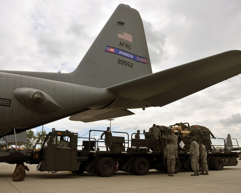 A load team uses a K-Loader to load a Humvee into the cargo area of a C-130 Hercules at Aviano Air Base, Italy on April 10, 2016. The Humvee was then air dropped over Hohenfels Training Area, Germany in support of Exercise Saber Junction 16. (U.S. Air Force photo/ Senior Airman Andrew J. Park)