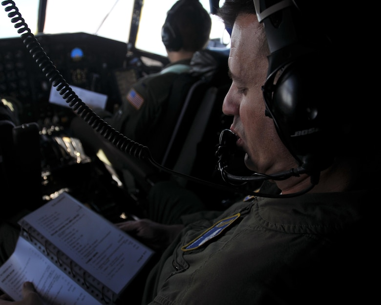 Master Sgt. Scott Randall, 700th Airlift Squadron flight engineer, reviews a checklist during the C-130's flight from Aviano Air Base, Italy to Hohenfels Training Area, Germany on April 11, 2016. The 94th Airlift Wing participated in Exercise Saber Junction 16 April 11-15. (U.S. Air Force photo/ Senior Airman Andrew J. Park)