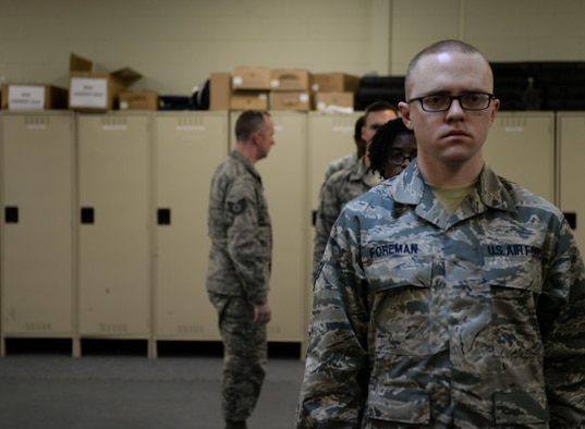 Tech. Sgt. Daniel Hill, 366th Force Support Squadron base honor guard flight chief, looks over potential honor guardsmen at Mountain Home Air Force Base, Idaho, March 3, 2016. Upon qualification the airmen will be on a one-year rotation as honor guardsmen. (U.S. Air Force photo by Senior Airman Jessica H. Evans/RELEASED)