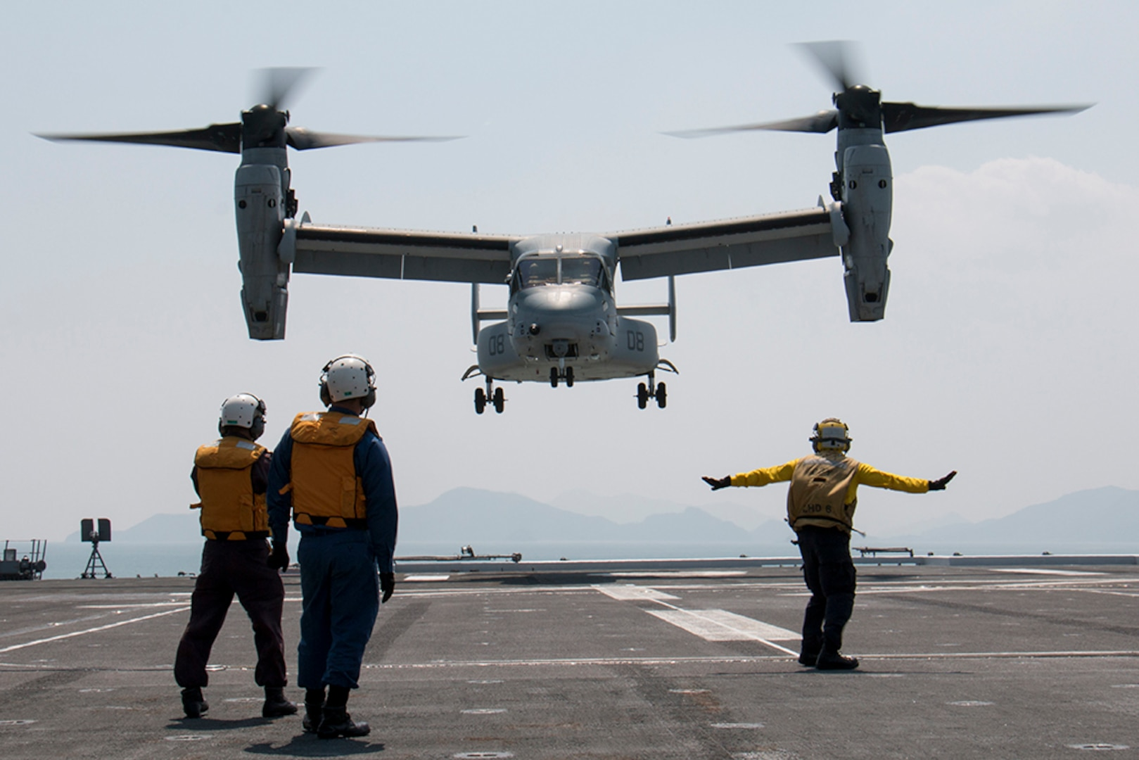 KUMAMOTO, Japan (April 19, 2016) - U.S. Marine Corps MV-22B Osprey lands aboard the destroyer helicopter ship JS Hyuga while supporting Japan's earthquake relief efforts near Kumamoto. The Osprey is assigned to Marine Medium Tiltrotor Squadron 265, 31st Marine Expeditionary Unit.