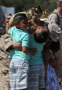 MARINE CORPS BASE CAMP PENDLETON, Calif. – Staff Sgt. Damian Fonseca, a training chief with Special Purpose Marine Air-Ground Task Force - Crisis Response - Central Command 16.1, from Modesto, Calif., embraces his children at a homecoming ceremony on Camp Pendleton April 17, 2016. SPMAGTF-CR-CC is a rotational contingent of approximately 2,300 Marines and sailors sourced from units throughout I Marine Expeditionary Force. This unit has become an integral part of Operation Inherent Resolve, providing kinetic and non-kinetic strike capabilities, aviation logistics support to operations across Iraq, a dedicated Tactical Recovery of Aircraft and Personnel force, and the security forces aboard Al-Taqaddum Air Base and Al Asad Air Base, Iraq. (U.S. Marine Corps photo by Cpl. Angel Serna/Released)