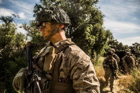 MARINE CORPS BASE CAMP PENDLETON, Calif. – Lance Cpl. Wesley Craddock, automatic rifleman, Company K, 3rd Battalion, 1st Marine Regiment, 1st Marine Division, patrols his way to his squad's first objective during squad tactics training at Camp Pendleton April 19, 2016. The training focused on basic combat marksmanship and communication within squads. Craddock is 22 years old and is from Detroit. (U.S. Marine Corps photo by Sgt. Emmanuel Ramos/Released)