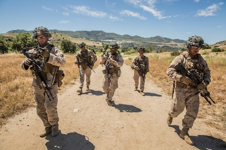 MARINE CORPS BASE CAMP PENDLETON, Calif. – Cpl. Jesse Meinhardt, center, squad leader, Company K, 3rd Battalion, 1st Marine Regiment, 1st Marine Division, leads his squad to the starting point during squad tactics training on Camp Pendleton April 19, 2016. In addition to day attacks, squads also conducted night assaults. Meinhardt is 22 years old and is from Auburn, Alabama. (U.S. Marine Corps photo by Sgt. Emmanuel Ramos/Released)