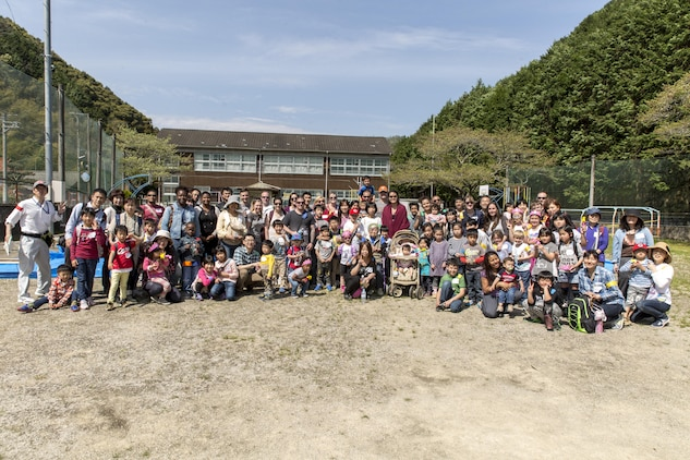 Residents from Marine Corps Air Station Iwakuni pose with Japanese civilians and volunteers for a group photo during a Mochitsuki – rice pounding – event at Tenno Elementary School in Tenno, Japan, April 16, 2016. The event offered residents the opportunity to interact with Japanese civilians and experience a different part of their culture. (U.S. Marine Corps photo by Lance Cpl. Aaron Henson/Released)