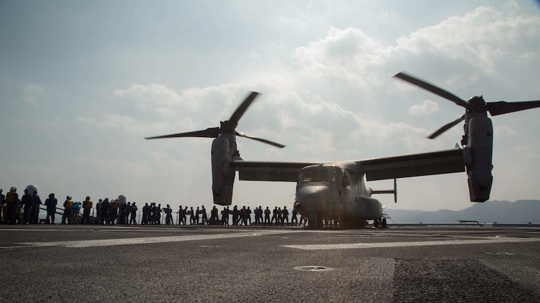 Marines assigned to Marine Medium Tiltrotor Squadron 265 (Reinforced), 31st Marine Expeditionary Unit, and Japan Self-Defense Force members transport supplies onto an MV-22B Osprey aboard the JS Hyuga (DDH 181), April 19, 2016. The supplies are in support of the relief effort after a series of earthquakes struck the island of Kyushu. The 31st MEU is the only continually forward-deployed MEU and remains the Marine Corps' force-in-readiness in the Asia-Pacific region.
