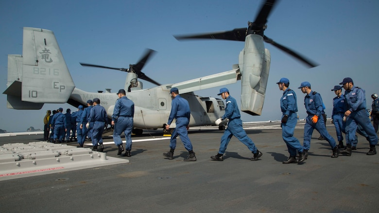 U.S. Marines assigned to Marine Medium Tiltrotor Squadron 265 (Reinforced), 31st Marine Expeditionary Unit and Japan Self-Defense Force members transport supplies onto an MV-22B Osprey aboard the JS Hyuga (DDH 181), April 19, 2016. The supplies are in support of the relief effort after a series of earthquakes struck the island of Kyushu. The 31st MEU is the only continually forward-deployed MEU and remains the Marine Corps' force-in-readiness in the Asia-Pacific region.