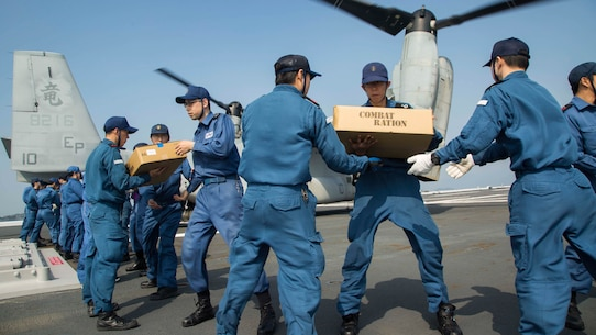 U.S. Marines assigned to Marine Medium Tiltrotor Squadron 265 (Reinforced), 31st Marine Expeditionary Unit, and Japan Self-Defense Force members transport supplies onto an MV-22B Osprey aboard the JS Hyuga (DDH 181), April 19, 2016. The supplies are in support of the relief effort after a series of earthquakes struck the island of Kyushu. The 31st MEU is the only continually forward-deployed MEU and remains the Marine Corps' force-in-readiness in the Asia-Pacific region.