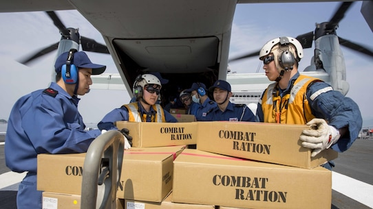 Japan Maritime Self Defense Force personnel, U.S. Navy sailors and U.S. Marines load supplies onto a U.S. Marine Corps MV-22B Osprey tiltrotor aircraft from Marine Medium Tiltrotor Squadron 265, 31st Marine Expeditionary Unit aboard the JS Hyuga, at sea, April 20, 2016. The supplies are in support of the relief effort after a series of earthquakes struck the island of Kyushu. The 31st MEU is the only continually forward-deployed MEU and remains the Marine Corps' force-in-readiness in the Asia-Pacific region.