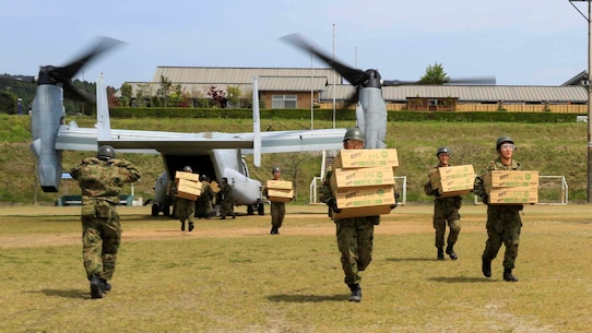 Japan Ground Self Defense Force personnel carry supplies from a U.S. Marine Corps MV-22B Osprey tiltrotor aircraft from Marine Medium Tiltrotor Squadron 265, 31st Marine Expeditionary Unit, in Hakusui Sports Park, Kyushu island, Japan, April 20, 2016. The supplies are in support of the relief effort after a series of earthquakes struck the island of Kyushu. The 31st MEU is the only continually forward-deployed MEU and remains the Marine Corps' force-in-readiness in the Asia-Pacific region.