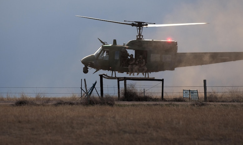 A 37th Helicopter Squadron UH-1N Bell Helicopter prepares to land and drop off 790th Missile Security Forces Squadron Tactical Response Force Airmen April 14, 2016, outside a launch facility in the F.E. Warren Air Force Base, Wyoming, Missile Complex. The 37th HS supports the mission of the 90th Missile Wing by providing aerial surveillance and emergency deployments of security response forces throughout the base and missile field. (U.S. Air Force photo by Senior Airman Brandon Valle)