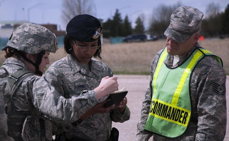 First Lt. Brittnay Taboada, 90th Security Forces Squadron, briefs the security forces on-scene commander, Master Sgt. Kimberly Rumph, and the incident commander, Tech. Sgt. Garey Schmidt, during an exercise on F.E. Warren Air Force Base, Wyoming, April 13, 2016. Security forces were the first to arrive at the staging area and handed off control to the incident commander once the scene was secure. (U.S. Air Force photo by Senior Airman Brandon Valle)