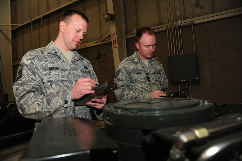 U.S. Air Force Master Sgt. Caleb Watkins, left, and Tech. Sgt. Jaime Farmer, both aircraft armament systems technicians assigned to the 131st Aircraft Maintenance Squadron (AMXS), prep a munitions handling unit (MHU)-204 trailer for loading procedures at Whiteman Air Force Base, Mo., April 14, 2016, Watkins and Farmer are two of three 131st AMXS drill-status guardsmen who loaded weapons to the B-2 Spirit during an exercise for the time during CONSTANT VIGILANCE 16. (U.S. Air Force photo by Airman 1st Class Keenan Berry)