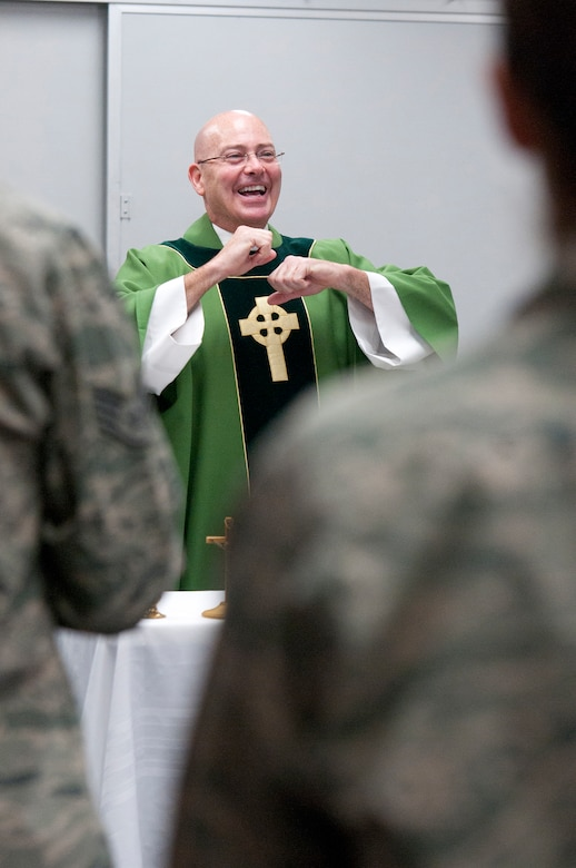 The newest chaplain at the 123rd Airlift Wing, Capt. Jeffrey Nicolas, conducts Catholic Mass at the Kentucky Air National Guard Base in Louisville, Ky., Oct. 18, 2015. Nicolas previously served as a chaplain in the U.S. Navy. (U.S. Air National Guard photo by Tech. Sgt. Vicky Spesard)